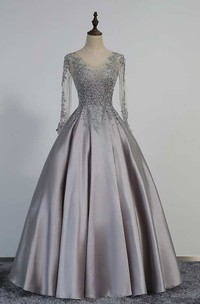 Illusion Long Sleeve V Neck Pleated Satin Ball Gown With Lace Detailing